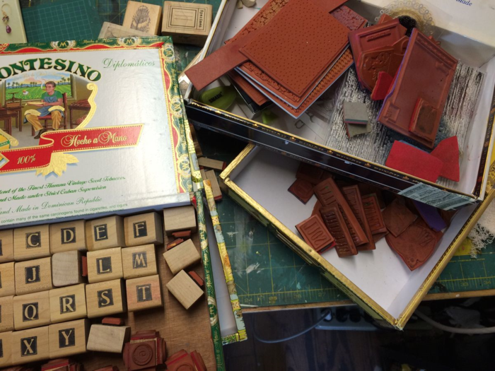 stamps in cigar boxes